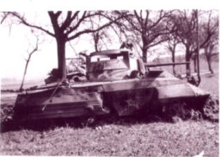 Remains of one of our M8's after being hit by German 88 - Wittich, Germany, 1945