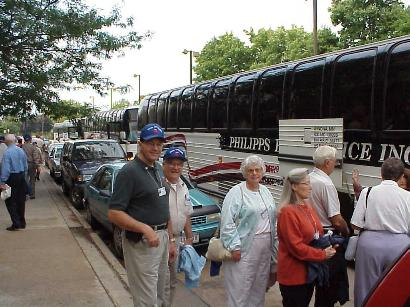Group loading on bus for tour of Fort McCoy Sept. 7, 2001 outside Raddison Hotel, La Crosse, WI