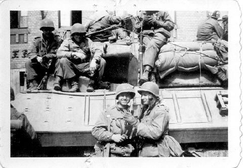 James Richard Knight is holding bottle standing on right of picture in front of tank